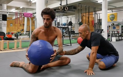 Felipe Toledo working on his core with Rodrigo from Surf Movement, Gold Coast